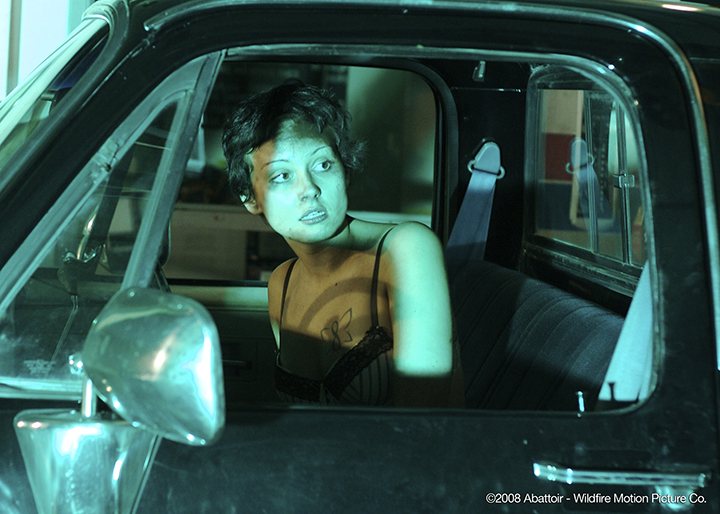 Kimmy in truck - (c)2008 Abattoir - Wildfire Motion Picture Co.
